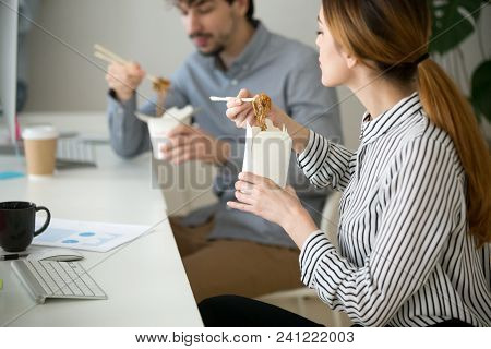 Office People Eating Chinese Noodles Holding Boxes At Lunch Time, Young Woman And Man Employees Enjo