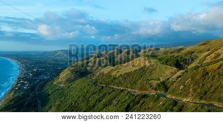 Kāpiti Coast Hills With A  Road Going Up Them.