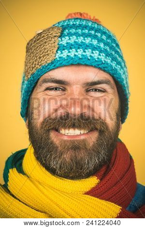 Casual Look. Handsome Bearded Man Wears Autumn Or Winter Clothing. Attractive Man In Hat With Scarf
