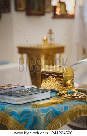 Christening In The Church, Golden Religious Utensils: Bible, Cross, Prayer Book, Missal. Details In