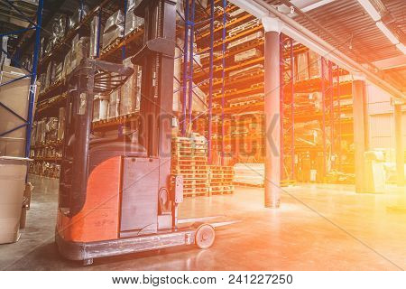 Logistics Equipment, Large Hangar Warehouse With Lots Shelves Or Racks With Pallets Of Goods. Indust