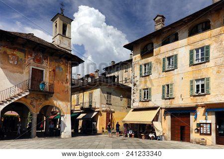 ORTA SAN GIULIO, ITALY - 10 MAY, 2018 - Street scene in Orta San Giulio, famous resort on the western shore of Orta Lake, Italy, Europe