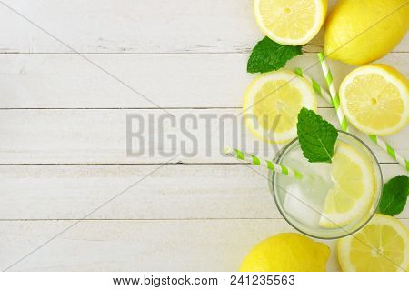 Sweet Summer Lemonade. Top View Side Border With Copy Space On A Rustic White Wood Background.