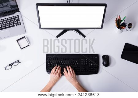 Elevated View Of A Businessperson's Hand Using Computer