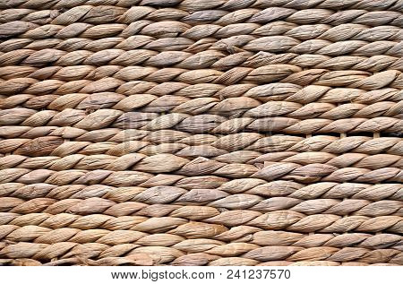 Background Texture Of Beige Or Straw Colored Wicker Or Seagrass.