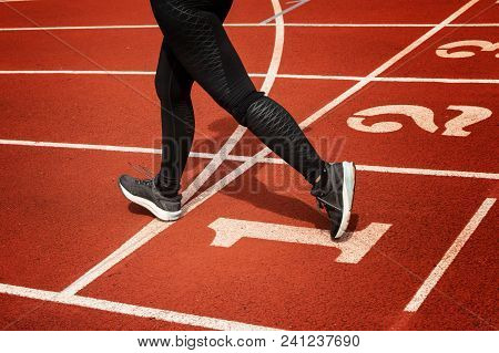 Athletic Female Legs And Running Shoes Of Sport Woman Jogging On Running Race