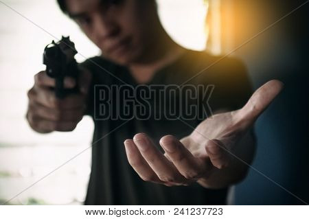 Gangster Or Thief Hold The Gun In Hand Weapon For Steal Wallet