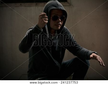 Hoody Man With A Knife In Dark Room