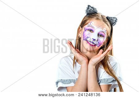 Portrait of teen girl with cat face painting
