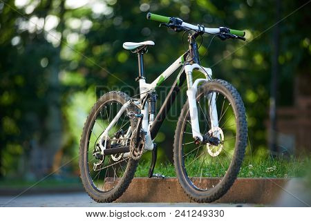 Mountain Bike Parked Near Paved Roadside In Green Sunny Park. Conept Of Healthy Lifestyle, Outdoor A