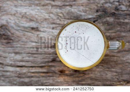 Beer Jug On Wood Background, Top View