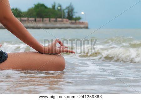 Serenity, Meditation And Yoga Practicing At The Sea