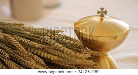Golden Chalice And The Ears Of Wheat Over An Altar In Christian Church