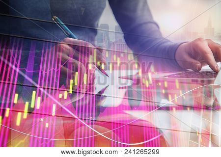 Hands Using Laptop With Digital Forex Chart On Abstract City Background. Analytics And Strategy Conc