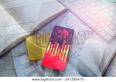 Top View Of Smartphone With Forex Chart Placed On Office Desk With Supplies. Statistics And Technolo