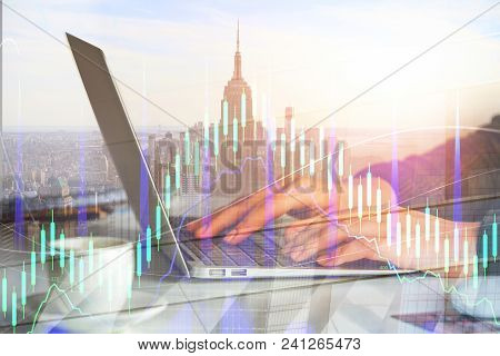 Hands Using Laptop With Digital Forex Chart On Abstract City Background. Analytics And Accounting Co