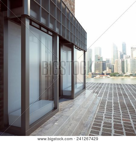 Side View Of Contemporary Glass Storefront Exterior On City Background. 3d Rendering