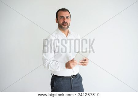 Portrait Of Confident Mid Adult Manager With Digital Tablet. Caucasian Bearded Man Wearing White Shi