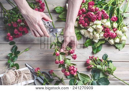 Florist At Work. Female Hands Collect A Wedding Bouquet Of Roses. People In The Process Of Work