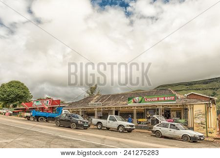 Bulwer, South Africa - March 23, 2018: A Street Scene With Businesses, Vehicles And People In Bulwer