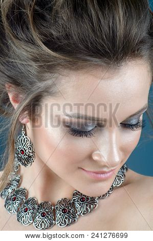 Beautiful Woman With Brown Hair Fresh Skin Wearing Accessories And Jewelry Isolated Over Dark Blue B