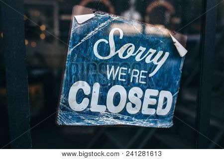 Inscription On A Door: Sorry We Are Closed. Conceptual Photo Or Table On Door With Information Of Wo