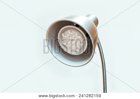 Close-up Of A Led Lamp White And Red Color. Round Table Lamp With A New Technology Lamp On White Bac
