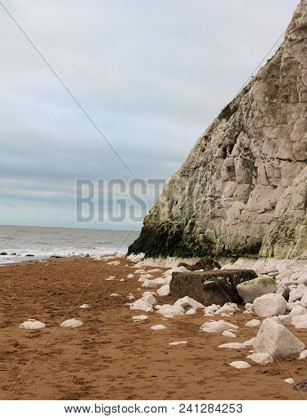 Botany Bay Cliff And Loose Rocks By Sea