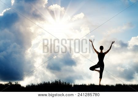 Yoga Meditation, Woman Stand With Raised Arms In Nature, Human Meditating Over Sun Sky Background