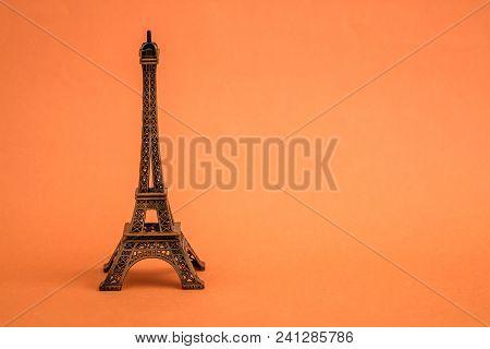 Statue Model Of Eiffel Tower On Orange Background
