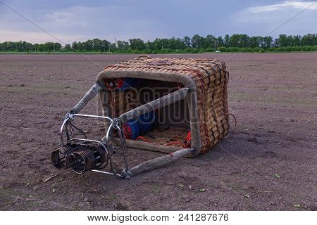 The Basket With The Burners For The Balloon Lies On The Ground. Preparation Of A Balloon For Flight.