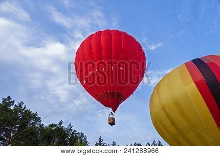 A Balloon Filled With Hot Air Rises To The Top To The Shelves. Balloon In Flight. Festival Of Balloo