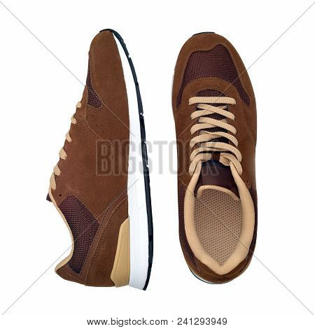 Pair Of New Modern Brown Sneakers Isolated On White Background With Clipping Path. Men Shoes. Top Vi