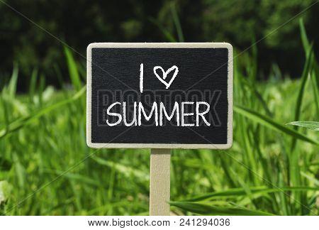 I Love Summer Written In Chalkboard. Sign On A Green Lawn. Photo Stock.