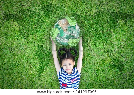 Sustainable World Environment And Csr With People Campaign Concept With Girl Kid Raising Earth On Gr
