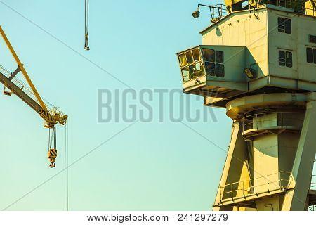 Cockpit Of Port Crane, Industry Detail. Blue Sky Background