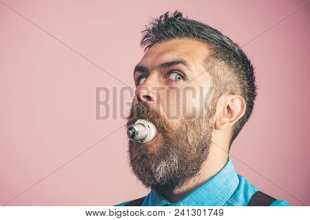 Handsome Man In Denim Shirt With Light Bulb In Mouth. Grown Man Choked From Light Bulb. Lightbulb In