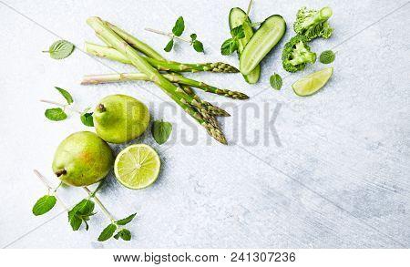 An Arrangement of Green Vegetables,  Fruits and Herbs; flat lay