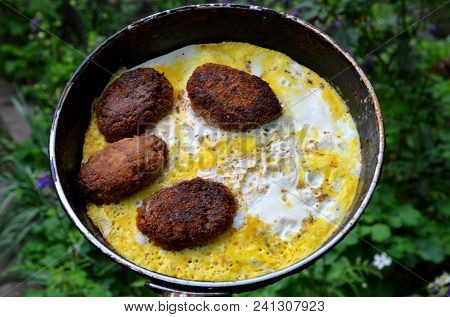 Buckwheat Meat Patties Are Fried In A Frying Pan With Fried Eggs.