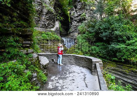 A Photographer At The Water Falls In The Watkins Glen State Park In New York