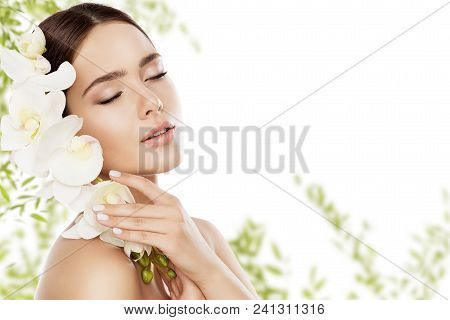 Beauty Skin Care And Face Makeup, Woman Skincare Natural Make Up, Beautiful Model And Orchid Flower,