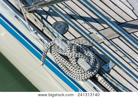 Mooring Rope With A Knotted End Tied Around A Cleat On A Yacht Side