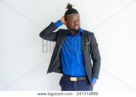 Pensive Concentrated Hipster African Businessman Scratching Head And Looking At Camera. Contemplativ