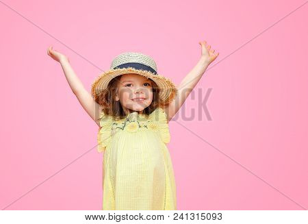 Close Up Portrait Of A Beautiful Girl In Yellow Dress And Straw Hat. Pretty Tenderness Kid Holding H
