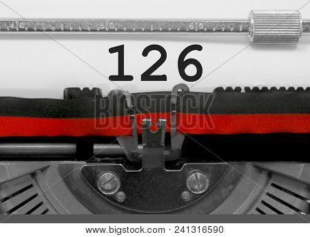 126 Number Text Written By An Old Typewriter On White Sheet