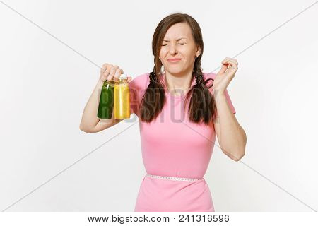 Woman Holds Green, Yellow Detox Smoothies In Bottles, Measure Tape On Waist Isolated On White Backgr