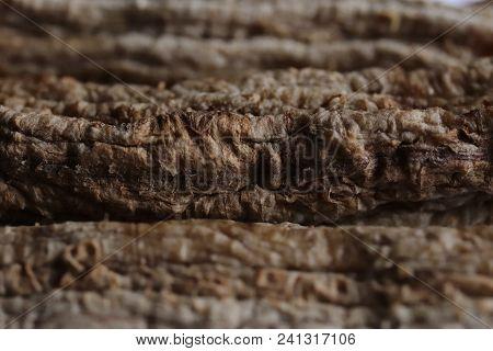 Drying Bananas Process. Stack Of Dried Bananas. Macro Closeup.