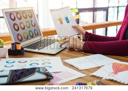 Young Woman Designer Working As Fashion Designers At Work With Fashion Sketches And Color Charts, Pr
