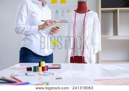 Stylish Fashion Designer Working With Measure Red Dummy As Sketches In Draft Book Of New Collection