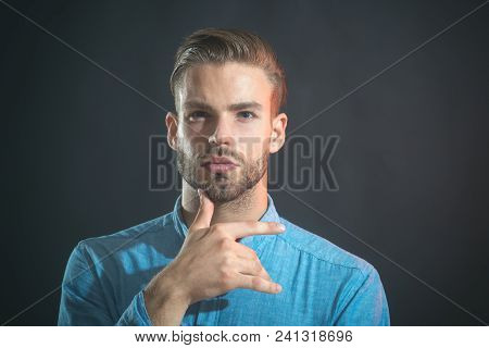 Thoughtful Attractive Man With Stylish Hair Hold Hand On Chin. Thinking Bearded Man Wearing Casual C